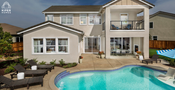 image of home's rear exterior with pool as example of preparing California home for summer